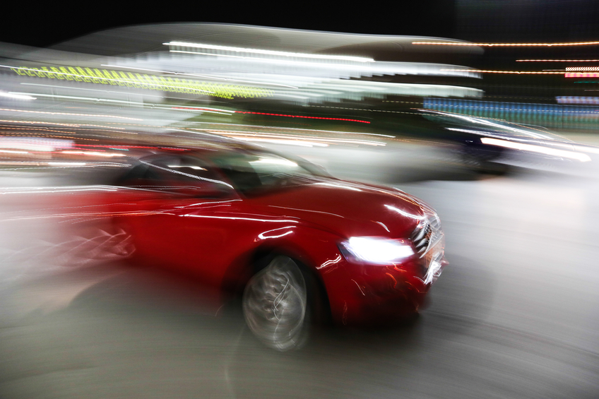 Red Car fast drive in motion
